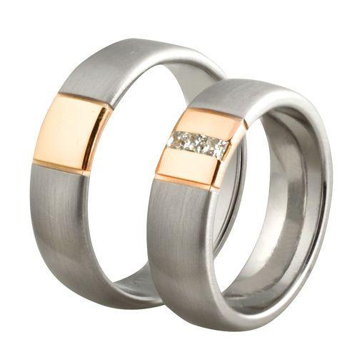 Obrączki ślubne z białego i różowego złota z diamentami o łącznej masie 0,12 ct. Próba 0,585