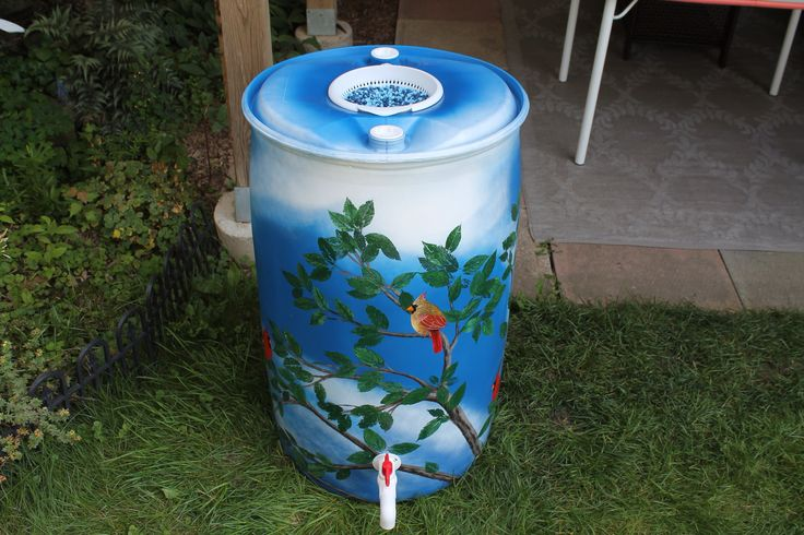 """-FOR SALE- Rain barrel #002 """"The Cardinal's Tree"""" Photo #1 of 4  """"The Cardinal's Tree"""" Complete with 5' of overflow tubbing, colored cleanable aquarium gravel filter system & all hardware parts are replaceable. One of a kind, hand painted with Krylon Fusion paint for plastic."""