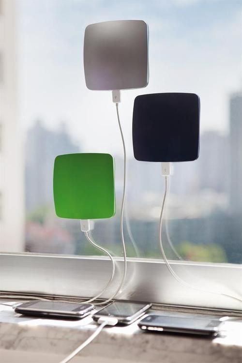 sticky window solar charger for cell phones... So cool want it