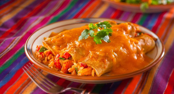 Crawfish Enchiladas recipe from Louisiana's own #Zatarains. Try this recipe and see why Louisiana crawfish are so amazing. #recipes #crawfish #cajun
