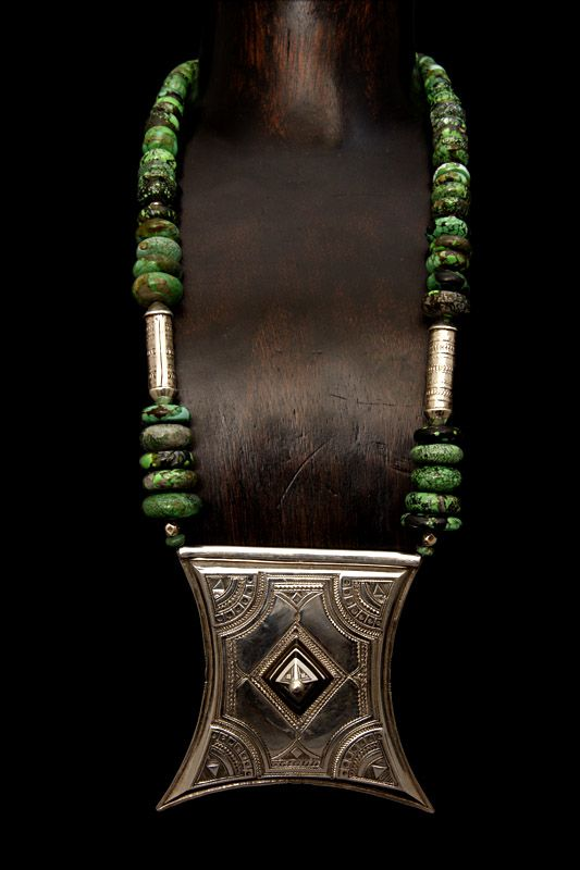"Necklace | Moussa Albaka ~ a leading Tuareg jeweler based in Mali.  Handcrafted sterling silver 'Tcherot' inlaid with ebony wood is combined with spider webs turquoise beads.  | Tuareg talisman boxes or ""Tcherot"" were worn on necklaces by Tuareg women and                                                                                                                                                                                 More"
