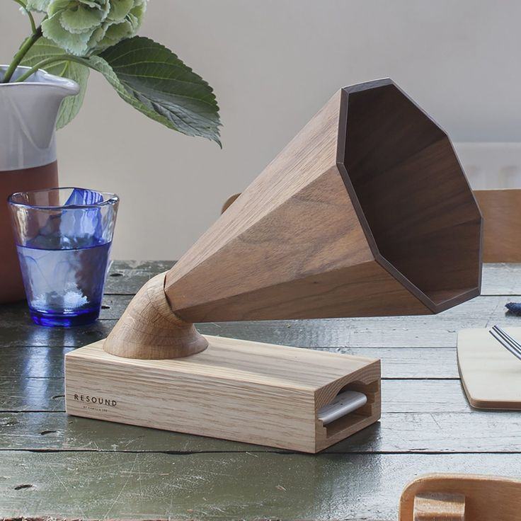 A beautiful handcrafted wooden amplifier that acts as a speaker for any iPhone. The wood naturally amplifies the iPhone's own speakers, adding a warmth to the sound. The design cleverly combines retro and modern styling, making it a beautiful addition to any space and a great unique gift for music lovers.
