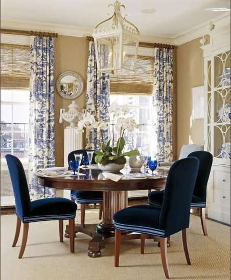 beautiful woven wood shades paired with blue toile curtains in an elegant dining room and - Dining Room Blinds