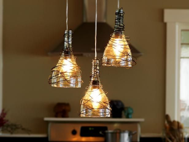 How to Make Wine Bottle Pendant Lights: Set aside a few empty wine bottles to create these delightful pendants for the kitchen. From DIYnetwork.com
