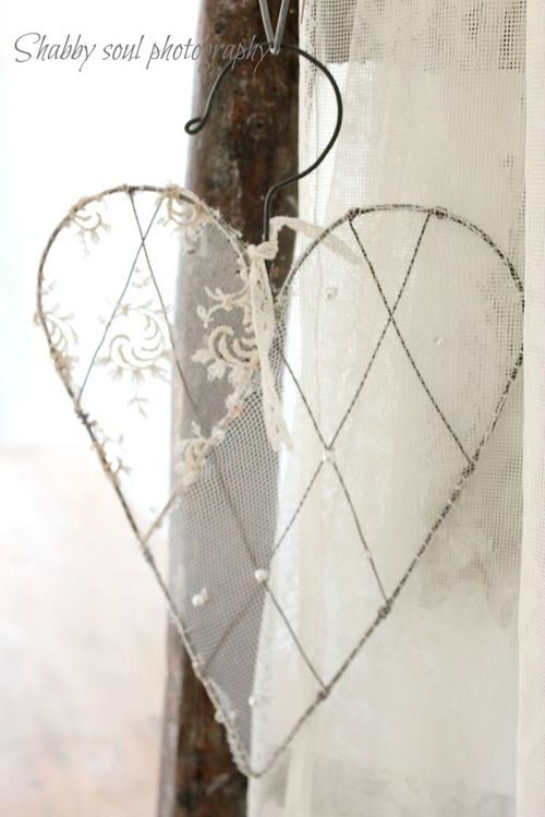shabby chic heart diy - 1) reform a hanger, 2) use craft/jewelry wire to form lattice pattern, 3) stretch lace or sheer fabric over heart and attach with thread, 4) Final touch: tie on a bit of lace at the top!