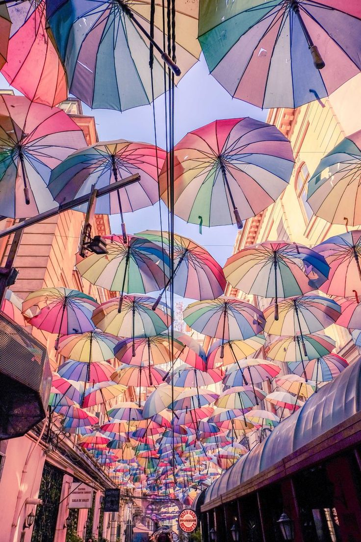 Victoria Passage Umbrellas - What is the first thought that comes to mind when you imagine things to do in Bucharest? Movies certainly portray the Romanian capital as an endless sea of grey concrete blocks, a post-communist country with bad music and angry people.