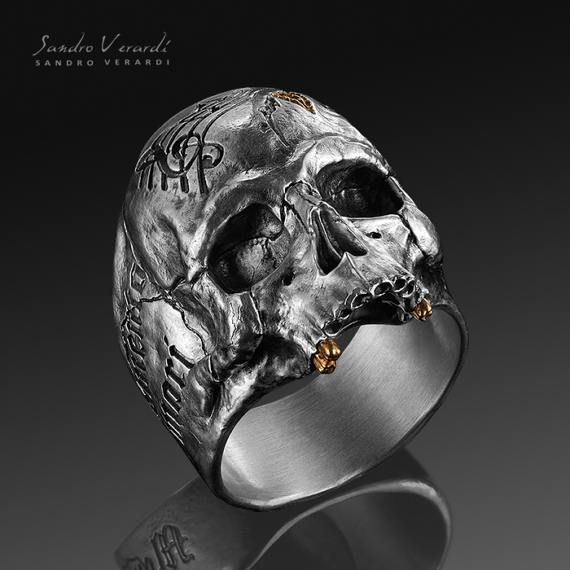 This precious skull ring from SANDRO VERARDI states Memento mori, Memento vivere and is something really special: `Remember that you must die, Remember that you must live' – This ancient latin saying serves to remind us of our mortality, of our mistakes and failures and at the same time to remind us to focus on the things that really matter in our lives. A massive and meaningful accessories that reminds us to live in the here and now! A matching pendant is available in our Shop. DETA...