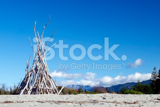 Driftwood Cairn, Motueka Spit, Tasman, New Zealand royalty-free stock photo