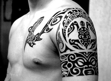 cool photo tattoo tribal on arm and chest blackwork