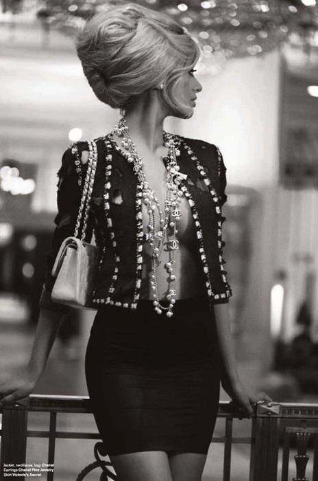 The classic Chanel suit with a twist, it was probably made circa 1960-70. The point in relation to the LBD is that designers buy plain fabric and then make it their own with hand-stitched embroidery, beads, buttons, lace etc. It is not about the expense but the creativity involved in the design.