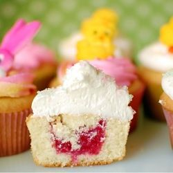 This delicious French Vanilla cupcake is enhanced with a sweet raspberry filling topped with Vanilla  Butter Cream frosting!