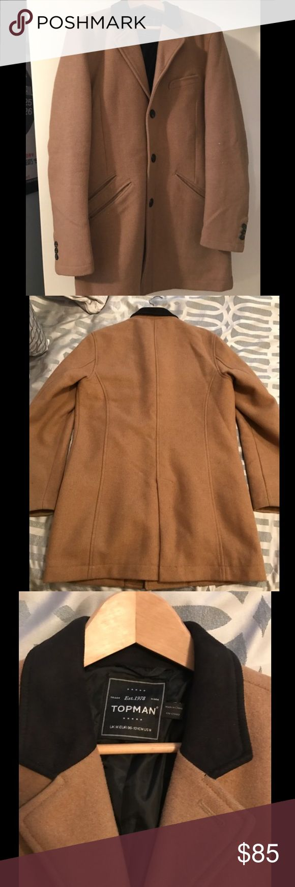 Topman tan pea coat size Medium Very good condition men's Topman coat in size Medium. Features: three-button cuffs, chest pocket; slit pockets, center vent. This coat is fully lined. 51% wool, 40% polyester, 4% viscose rayon, 3% nylon; 2% acrylic. Dry clean only. Topman Jackets & Coats Pea Coats