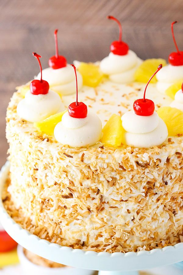 This Pina Colada Layer Cake has moist layers of coconut cake, homemade pineapple filling and coconut frosting! It's decorated with toasted coconut, cherries and pineapple for a tropical treat that is begging to hang with you this spring! 🙂 So I've been in Chicago for a few days now and tonight I'm spending a night …