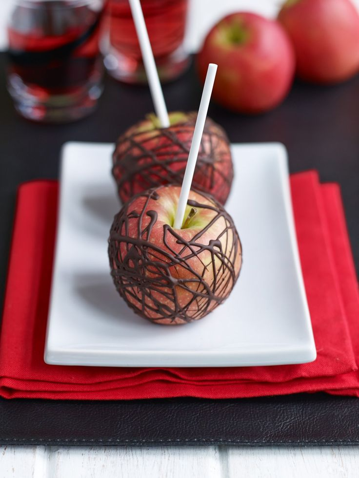 Great for Halloween or bonfire night. Pink Lady® apples on sticks, drizzled prettily with white and dark chocolate – like toffee apples but easier.