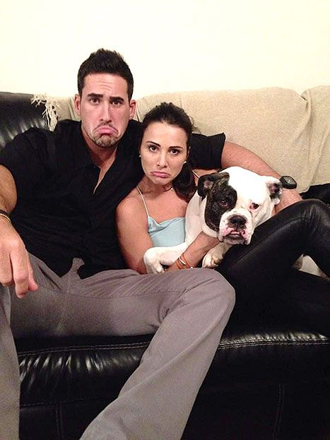 Turn those frowns upside down! Bachelorette Andi Dorfman proved she doesn't take herself too seriously by posing with fiance Josh Murray and his dog, Sabel, for a cute picture making fun of her perpetual frown. They are too cute!