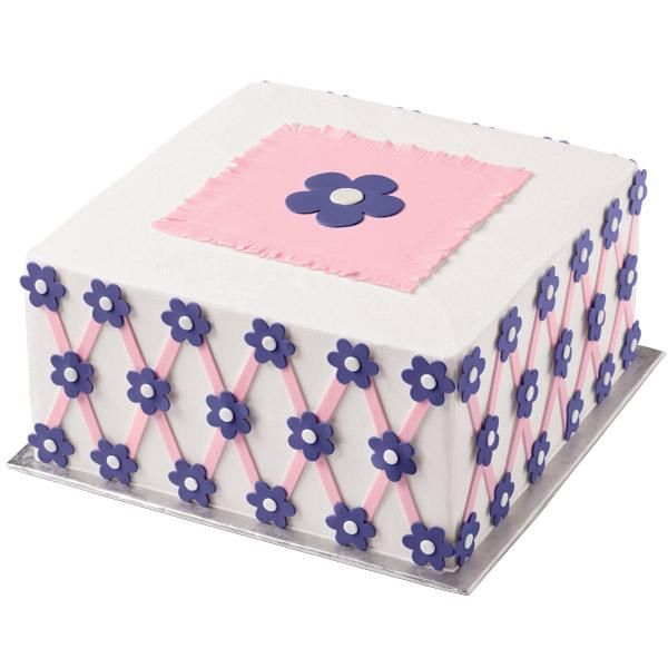 """This """"Vivid Violets Lattice Cake"""" is ideal for an afternoon tea or shower. Perfect flower shapes are cut using Sugar Sheets! and flower cutting inserts. Find a magic show that fits with your son or daughters age at http://idomagic.com/which-magic-show-for-you/"""