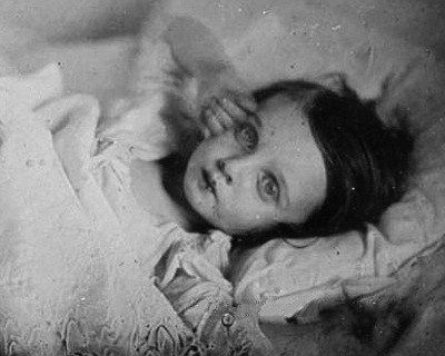 abinferis:    …The effect of life was sometimes enhanced by either propping the subject's eyes open or painting pupils onto the photographic print, and many early images have a rosy tint added to the cheeks of the corpse.    As interesting as it is, I haven't posted much about post-mortem photography before, just because its EVERYWHERE, but this image is particularly haunting!