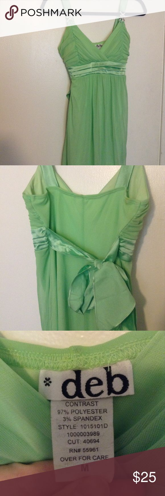 Lime green dress w/ crystal piece on sleeve | Deb Lime green dress from deb. Size medium. One of my favorite dresses I've owned. It no longer fits me so it's time for it to go to a new home! Straps are about two inches. Dress ends above the knee. Dress: 100% polyester. Lining: 97% polyester 3% spandex. Ribbon ties in back. Smoke free home. Small stains on backside near right shoulder and left side of back as shown in last two pictures. Deb Dresses