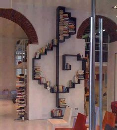 Music lovers will enjoy this creative, industrial, treble-clef-shaped bookshelf. We love this floor-to-ceiling statement!