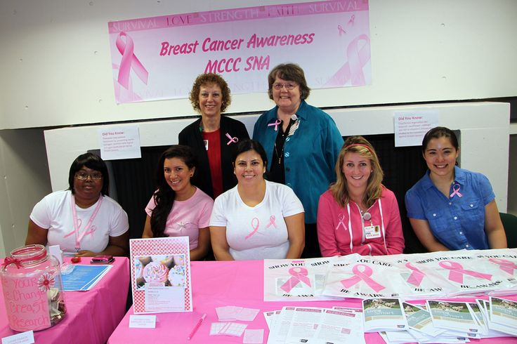 The Student Nurse Association manning a table during Breast Cancer Awareness Month.