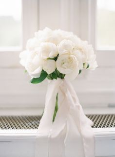 White peony wedding bouquet: Photography: Greg Finck - http://www.gregfinck.com   Read More on SMP: http://www.stylemepretty.com/2016/09/26//