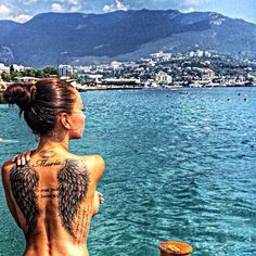 I like the placement & size of these wings...22 Wing tattoo for girl