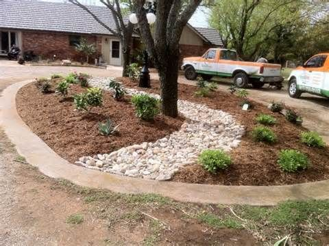 Help with my circular driveway island design front for Circular driveway landscaping pictures