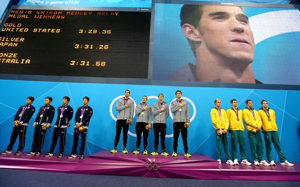Brendan Hansen and Nathan Adrian Photos Photos - Silver medallists Japan, gold medallists the United States and bronze medallists Australia pose on the podium in the medal ceremony for the Men's 4x100m medley Relay Final on Day 8 of the London 2012 Olympic Games at the Aquatics Centre on August 4, 2012 in London, England. - Olympics Day 8 - Swimming