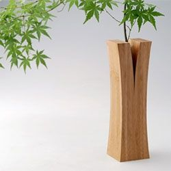 """Split wood"" vases from the Laminated Bamboo Lumber Project by Japanese design collective Teori. Yum."