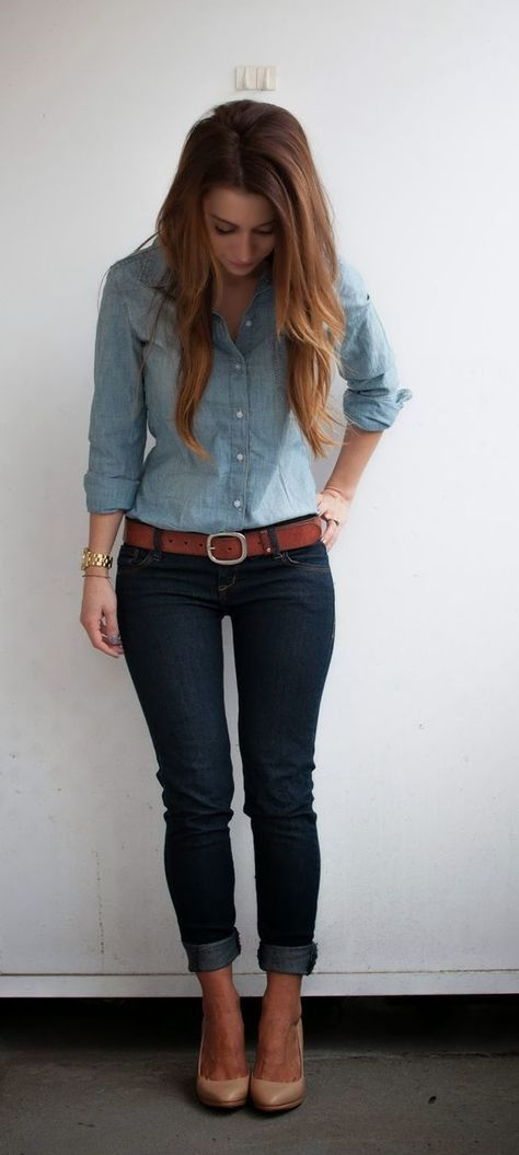 This combo of a baby blue denim shirt and navy blue skinny jeans will attract attention for all the right reasons. Polish off the ensemble with khaki leather pumps. Shop this look on Lookastic: https://lookastic.com/women/looks/denim-shirt-skinny-jeans-pumps/17122 — Light Blue Denim Shirt — Brown Leather Belt — Gold Watch — Navy Skinny Jeans — Tan Leather Pumps