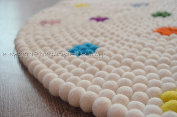 Snow white with flower design felt rug 120 cm, $302. Round felt ball rugs , felted rugs, Nepal handmade round rugs, free home delivery from Nepal by Myfeltballrugs on Etsy https://www.etsy.com/au/listing/386807786/snow-white-with-flower-design-felt-rug