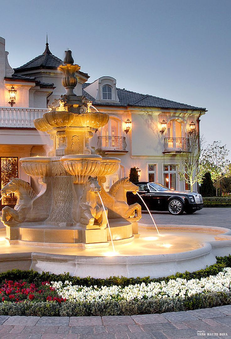 French chateau style driveway with fountain - Christina Khandan -  Irvine California Realtor - www.IrvineHomeBlog.com
