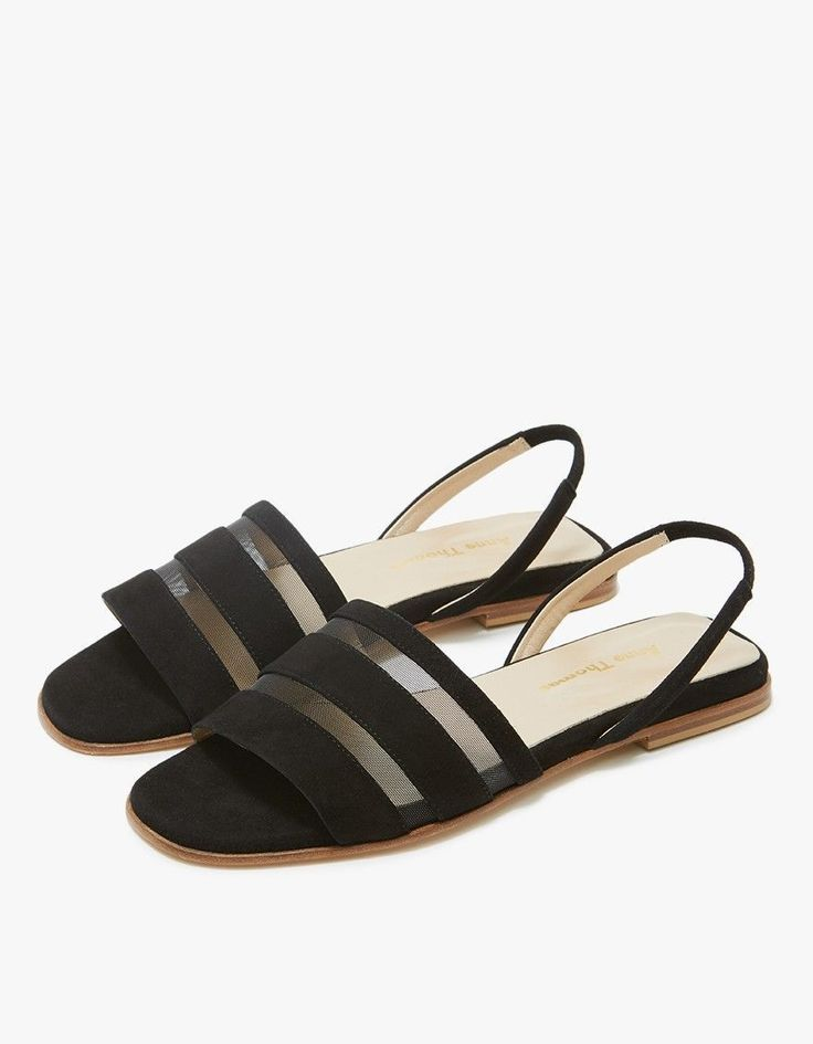 Slingback sandals from Anne Thomas in Black. Suede upper with mesh inserts.  Open toe. Subtle elastic insert at strap. Low stacked wood heel.