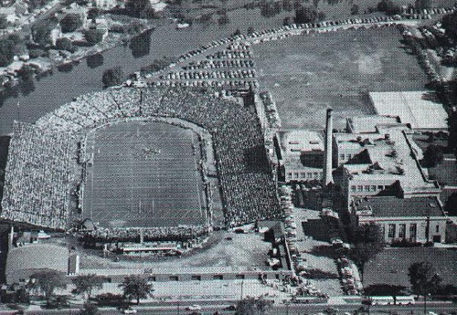 Old City Stadium - Green Bay, WI: This is where the Packers played before Lambeau Field. East High School is the big building on the right. It's still there today - minus all of those bleachers. :)