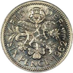 Sixpence - small and pretty with the Welsh leek, English rose, Scottish thistle and Irish clover.