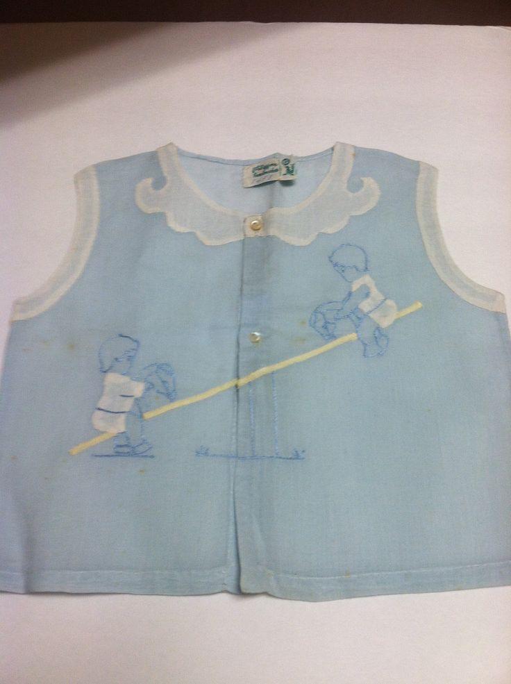 Adorable handmade diaper shirt.