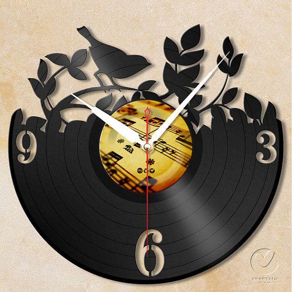 vinyl wall clock  garden bird by Anantalo on Etsy, ฿1100.00                                                                                                                                                      Más