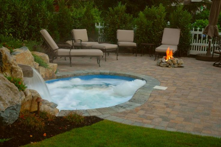 """Spool"" A spool is a small pool and spa conbined. It can be used for cooling off in the heat of summer and made hot on a cool evening. Great for parties! This one has a waterfall, landscaping, a paver patio and a gas fire pit. See the whole story at http://www.deckandpatio.com/DP_Blog/?p=1105"