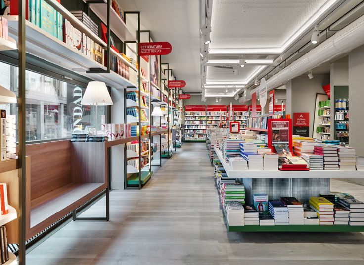 """The new #Mondadori #store is an innovative, #Italian space, expressing the original concept of """"#Mondadoriforyou"""" in a renovated dimension which guides the visitor in the heart of """"Mondadori Experience"""". A welcoming area to return to, of 'high density' products and people-friendly, where the visitors can easily find their way around at their own pace, depending on needs. #architecture #exhibition #design #stores"""
