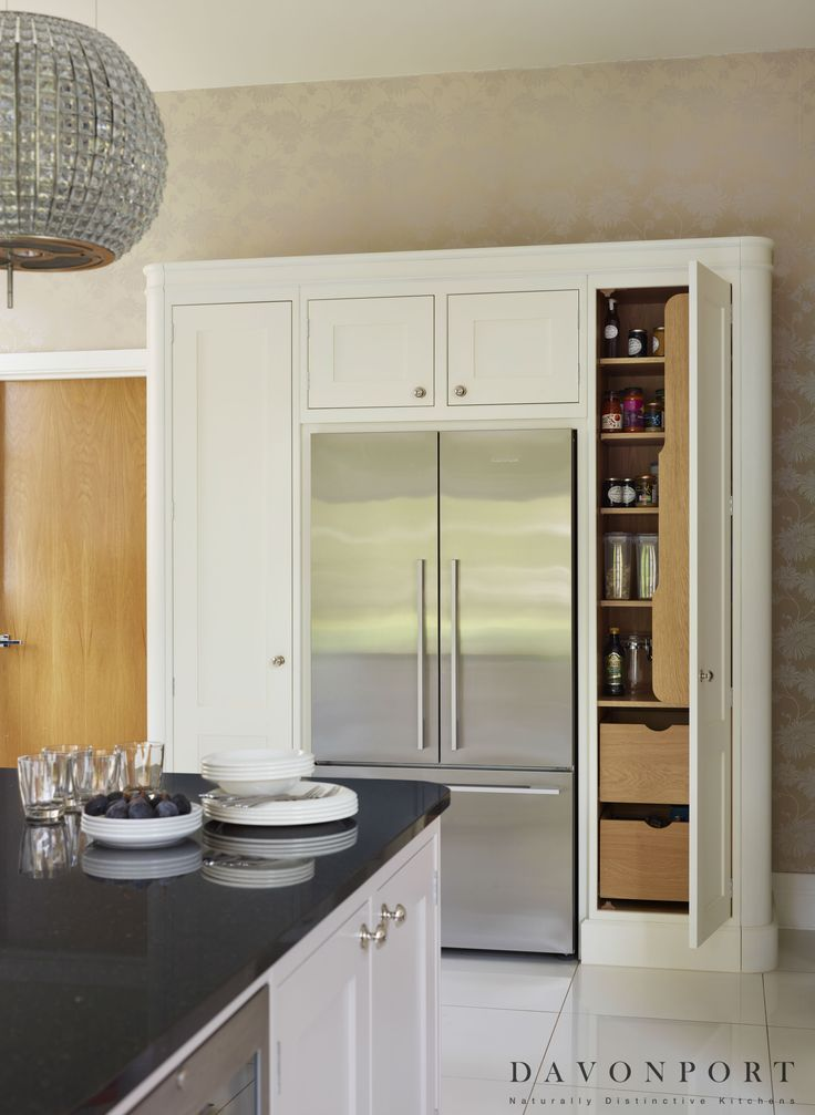 An alternative to a freestanding pantry, these larder cupboards that surround the fridge/freezer provide extra storage that seamlessly integrates in the room.