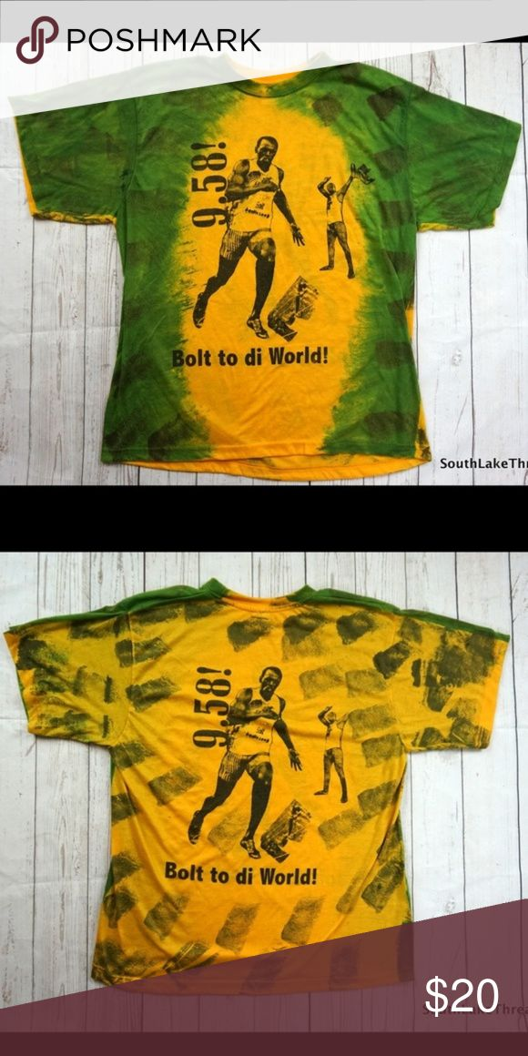 """Usain Bolt to Di World 9.58 Record T-Shirt Large Usain Bolt 9.58 Bolt to di World T-Shirt Jamacia Adult Large  Amazing T-Shirt, Very Soft, Amazing Style!  Brand: Big Brand Size: Adult Large Material: 100% Cotton  Detailed Measurements: (Front Side of Garment has been measured laying flat on a table)  Sleeves:             8.5"""" inches Chest:                21.5"""" inches Length:              27"""" inches Big Brand Shirts Tees - Short Sleeve"""