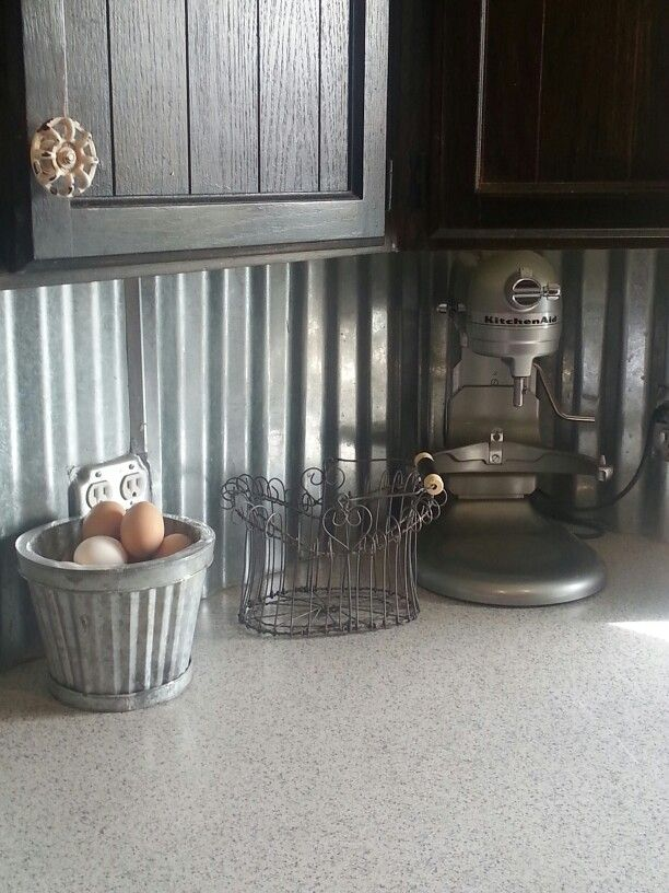 Rustic galvanized tin back splash. I love this.