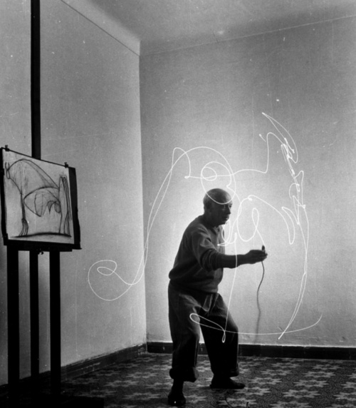 Pablo Picasso creating a picture with light, 1949. Photographed by Gjon Mili.