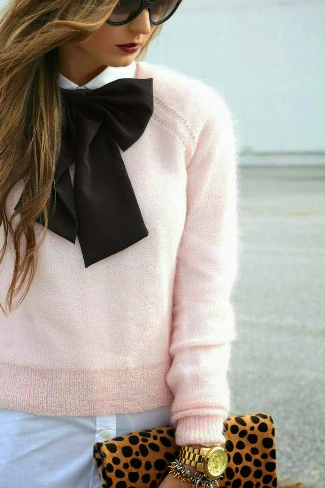 Add a bold touch to a pink sweater with a bold bow and leopard clutch
