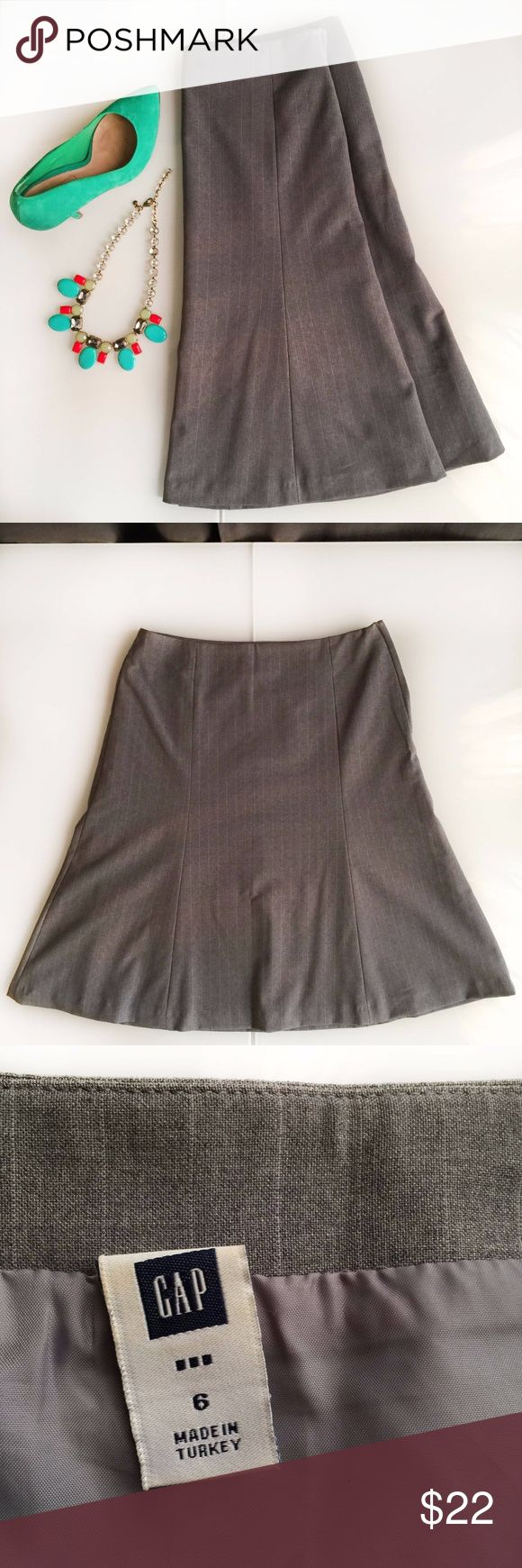 """Gap Pinstripe Grey Wool Skirt Gap Pinstripe Grey Skirt (light grey skinny vertical stripes)  Size 6 Fully lined Hidden side zipper A line  23.5"""" length 60% Wool, 36 polyester, 4% other fiber Excellent condition  I am also selling the awesome sea green/teal pumps by David Tutera. Message me for price.   All items come from an extremely clean and organized house - my mom taught me well!!  Smoke free. Pet free.  No trades please GAP Skirts A-Line or Full"""