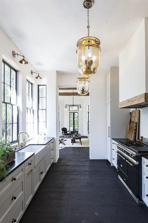 Black and white galley style kitchen