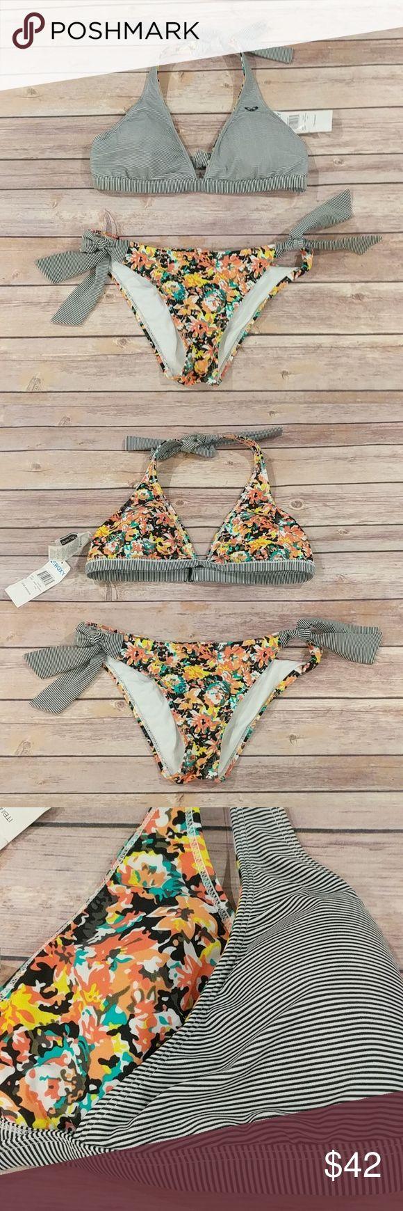 "Roxy reversible bikini top& bottom set ""new"" Never worn, new with tags on bikini top tag. (No bottom tags), beatiful flower & stripe design reversible top bikini set. It's like you own two bikinis!! Size large Roxy Swim Bikinis"