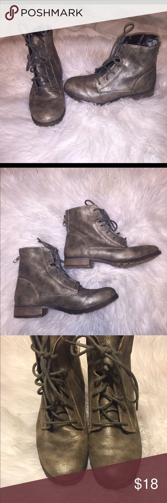 Pewter grey/gold metallic ankle combat boots Not the brand listed . These are mossimo .😊Metallic and shimmery ankle booties ! Overall in great condition ! Tiny scuff on one toe and bottoms have minor wear . Last two pics show flaws Steve Madden Shoes Combat & Moto Boots