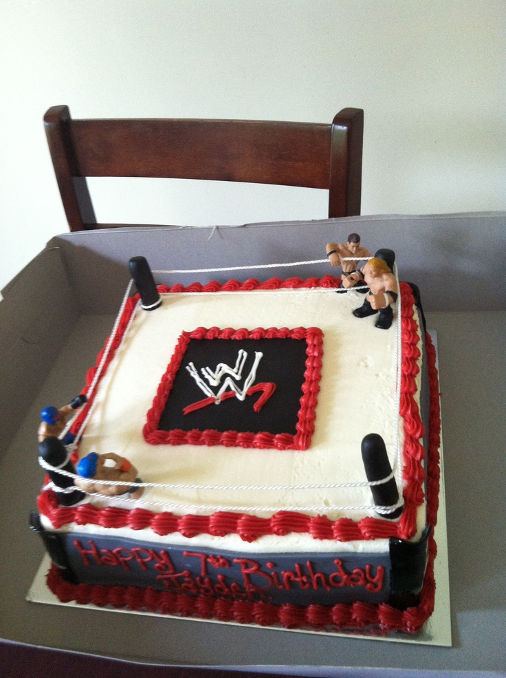Wrestling cake with the wrestlers on it ready to rumble!