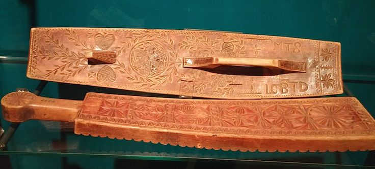 Various circle motifs on wooden work. Finland, 1800AD.